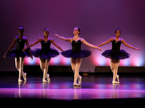 Middle school balareinas dancing on stage.
